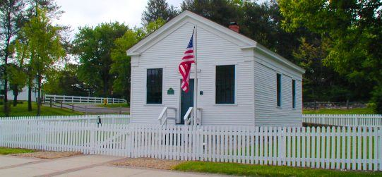 Schoolhouse exterior with fence