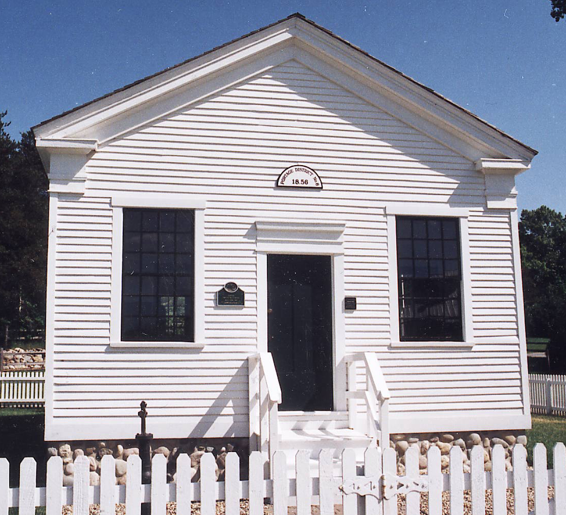 Schoolhouse entrance with a picket fence