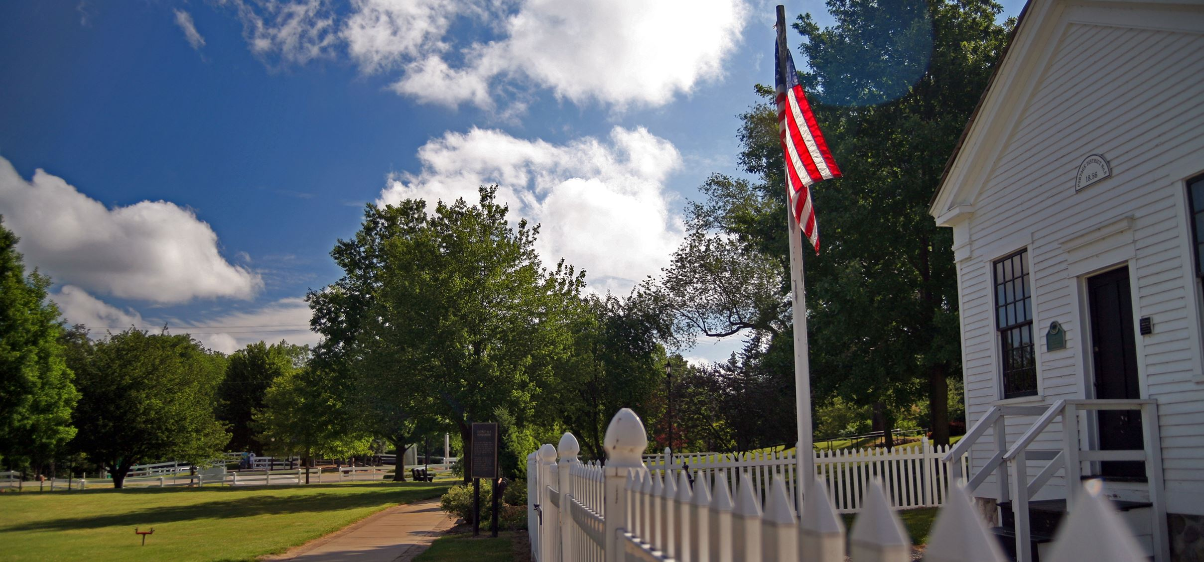 Celery Flats - View of american flag on pole outside picturesque white building
